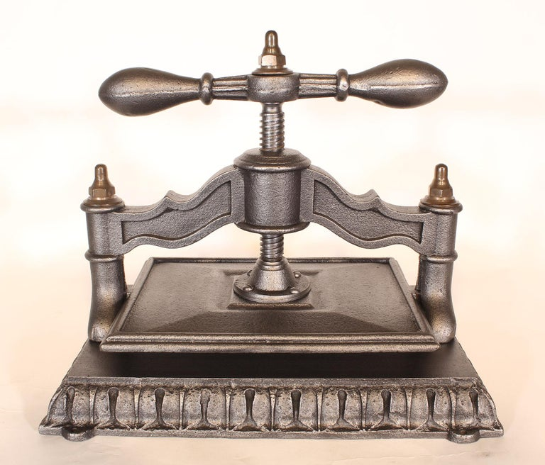 Antique book-binding press made of cast iron and brass. Measures: 2 1/2