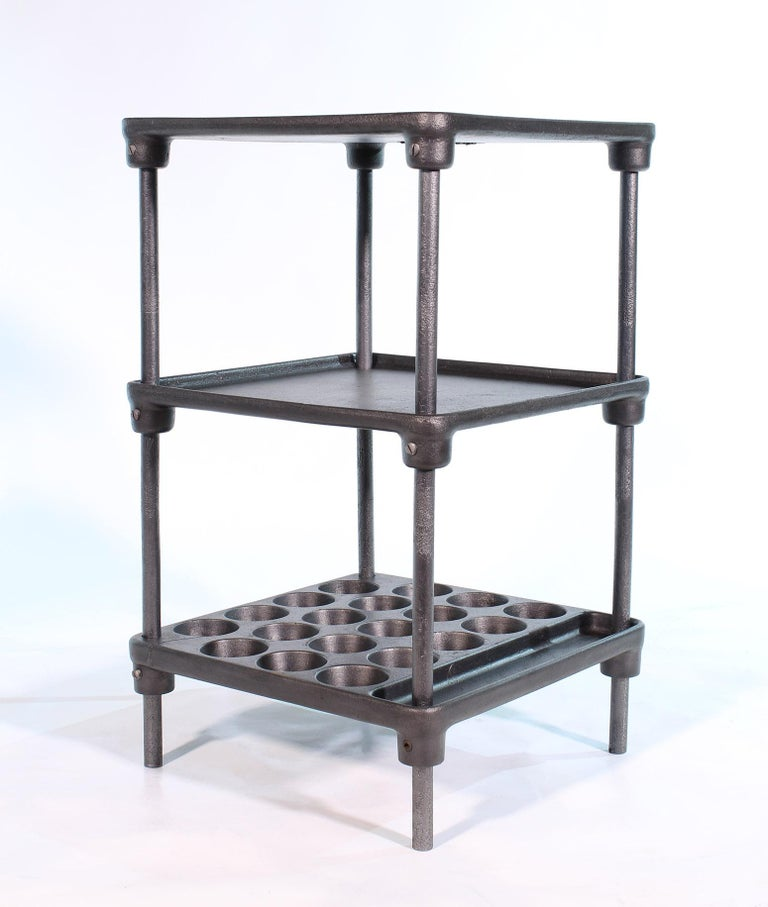 Three-tier vintage industrial cast-iron side / end machinists table, circa 1930s. Two cracks to the cast iron, one on top shelf and one on bottom shelf. 18