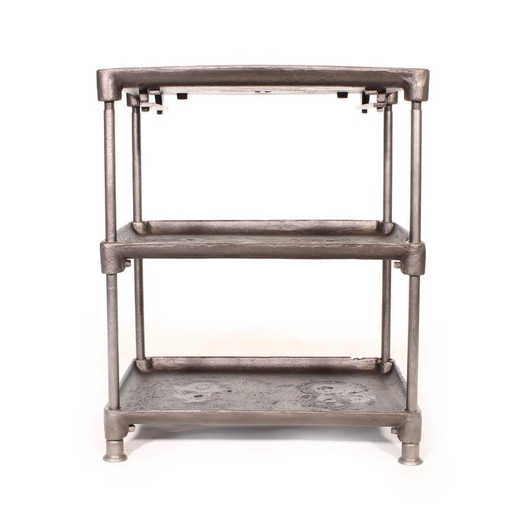 Three-tier cast iron vintage industrial side table, cart with adjustable shelves and cast iron feet. Bottom two shelves adjust via a square set screw. Dimensions are 25 1/4