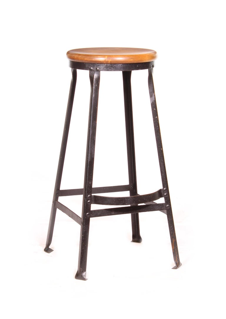 Vintage authentic industrial factory shop / bar / kitchen counter stool. Black worn steel with footrest and maple seat. 30