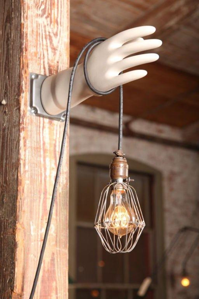 Original, vintage Industrial, caged Edison bulb hand glove mold lamp, light, wall sconce. Mold will vary slightly as they are vintage.