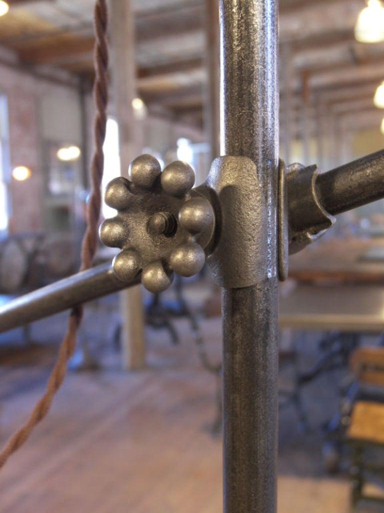 Bespoke vintage industrial adjustable cast iron floor lamp, task or reading light. Top arm is adjustable in height via a cast iron knuckle fitting. Angle is adjusted via a thumbscrew. Base measures 9 1/2
