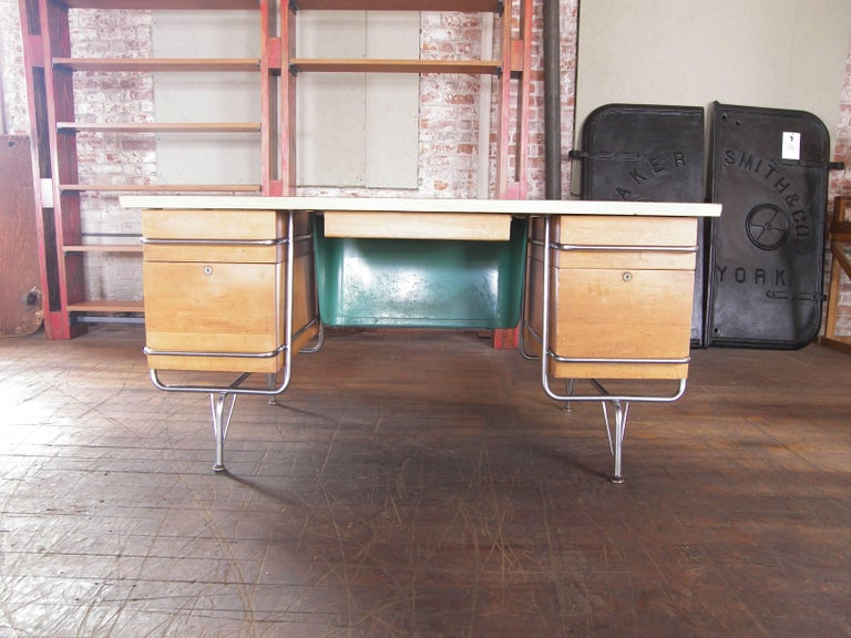 Authentic 1950s Mid-Century Modern Heywood-Wakefield Trimline model chrome and wood desk designed by KEM Weber. Overall dimensions measure 59 3/4