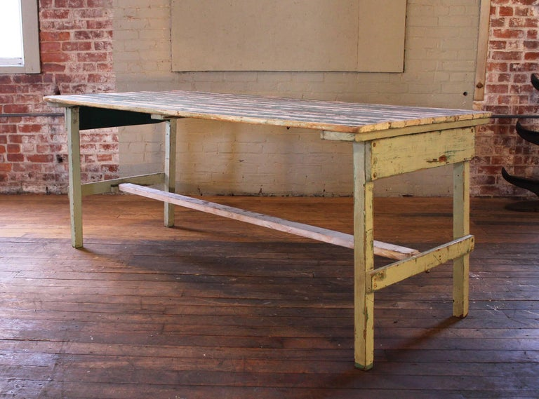 Authentic vintage rustic farm or country style collapsible wooden display table with distressed original paint. Table has movement to it due to the ability to fold up. More suitable as a display table for lighter objects. It would need to be