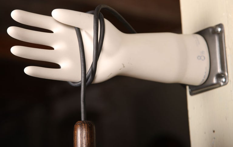 Industrial authentic vintage porcelain rubber glove mold hand wall sconce, lamp or light with caged Edison bulb. Authentic wooden drop light with new brass fitting and vintage steel cage. Arm measures 14 1/2