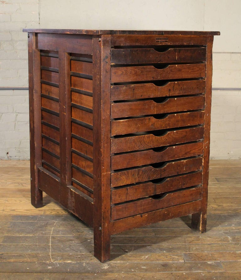 Authentic industrial style Hamilton Manufacturing Company wooden multi-drawer, flat-file printer's storage cabinet. Each drawer has dividers and inside dimensions are 30 1/2