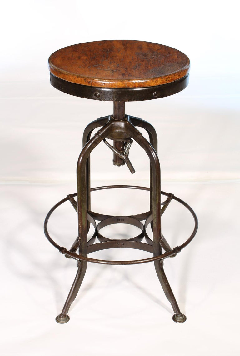 Vintage industrial authentic backless adjustable stool by Toledo. Seat height is adjustable 25 1/4
