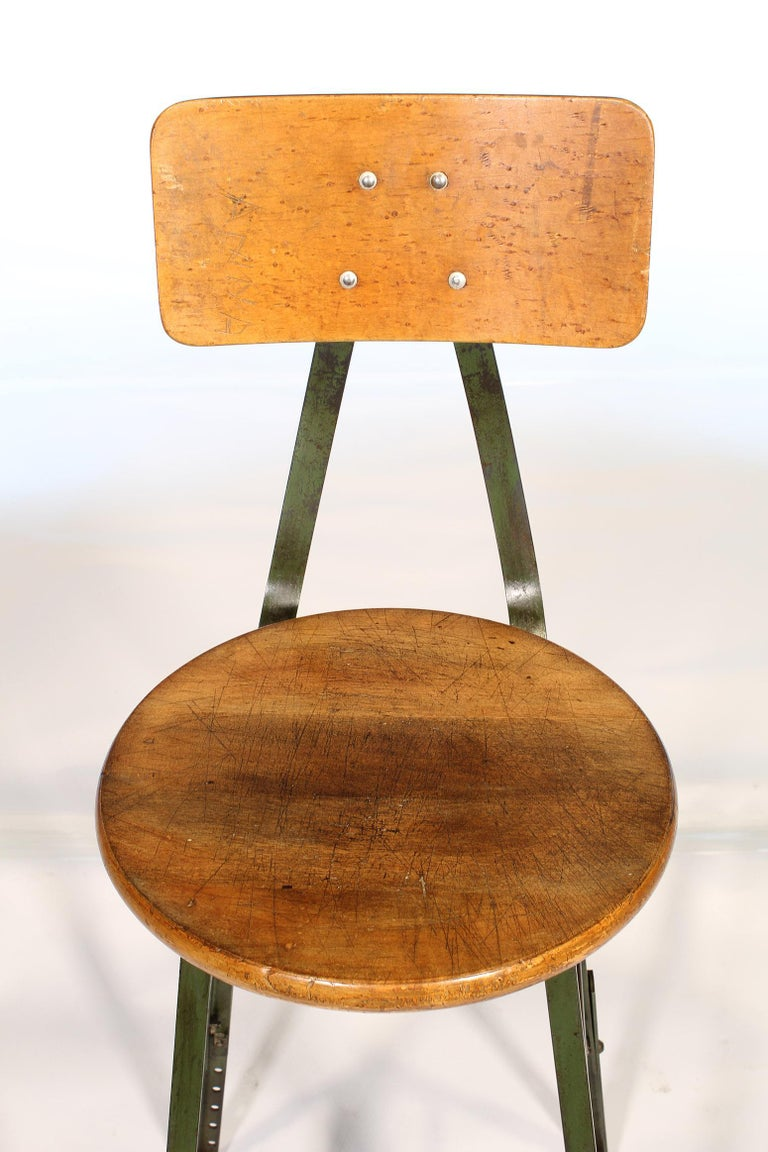 Authentic vintage factory industrial stool. Made from wood and steel. Distressed army green original paint. Seat diameter - 15