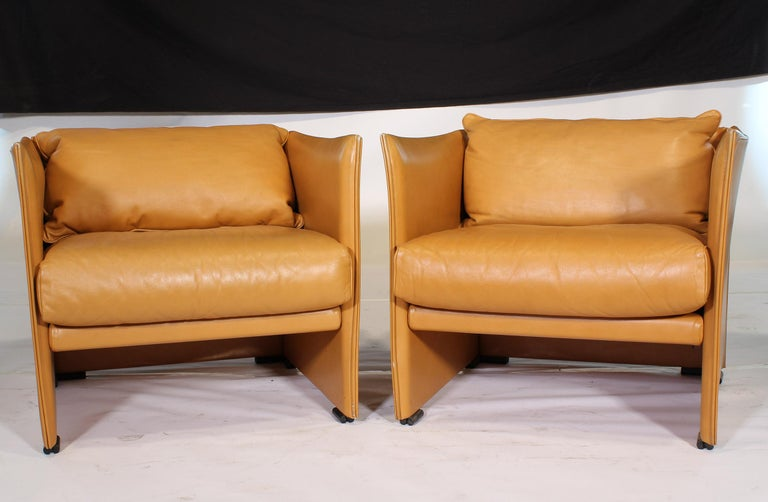 Authentic vintage set of 4 Mid-Century Modern Armchairs by Mario Bellini in light brown leather. We currently have the matching sofa available. This listing is for the four armchairs only.