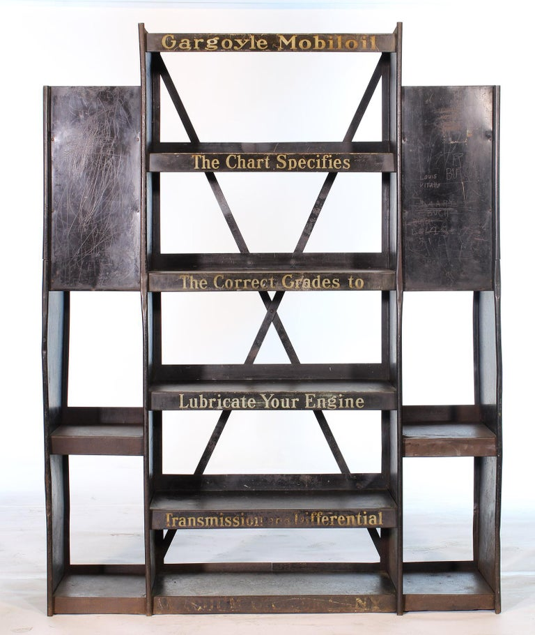 Authentic vintage automotive Mobil oil metal gargoyle display storage rack from the 1930s. Used to display oil cans at a garage or shop. An incredible piece of Automotive Americana Memorabilia. Would make an incredible dry bar or industrial style