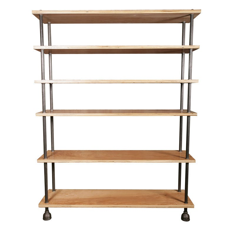 Industrial hand-finished plywood, steel and cast iron shelving / storage / bookcase unit is hand-built in our Connecticut workshop using all American parts. Adjustable feet for leveling. Can be made to your specifications and with different