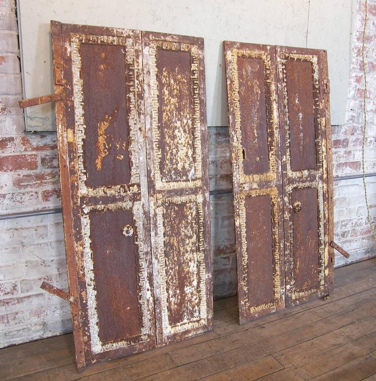 Pair of Antique Industrial Neoclassical Greek Key Cast Iron Doors Window Shutter In Distressed Condition For Sale In Oakville, CT