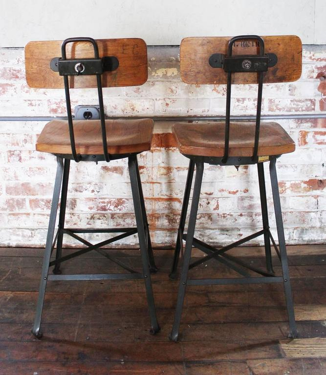 Pair of Vintage Industrial Wood and Metal Bar Stools For  : pairvintageindustrialwoodmetalstoolsadjustablegetbackincset27l from www.1stdibs.com size 667 x 768 jpeg 80kB