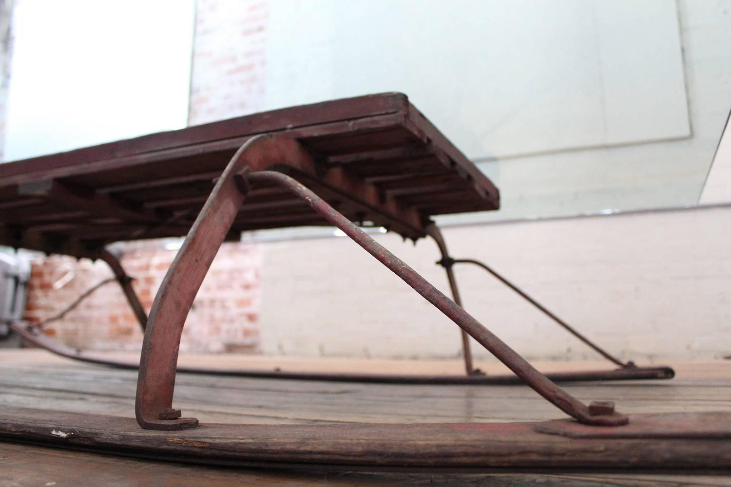 Vintage industrial wood and glass sled coffee table for sale at 1stdibs Antique sleigh coffee table