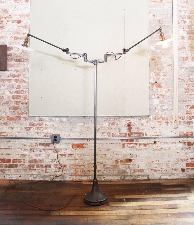 Adjustable double-arm machine task lamp with milk-glass shades and cast-iron O.C. White parts. Base measures 9 1/2