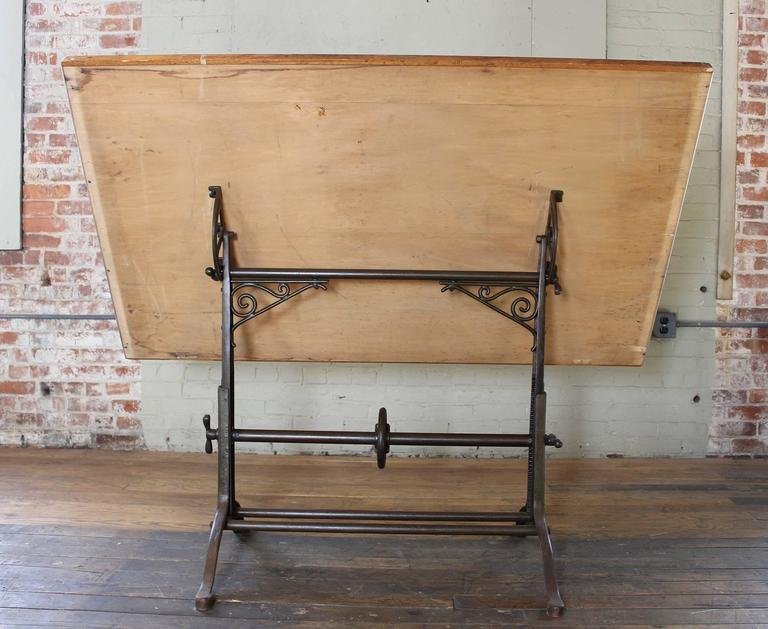"Vintage Industrial antique cast iron and wood ornate adjustable drafting, draftsman, architects table. Top measures 60 1/4"" x 37"". Top is adjustable from 31 1/4"" - 42 1/2"" in height."