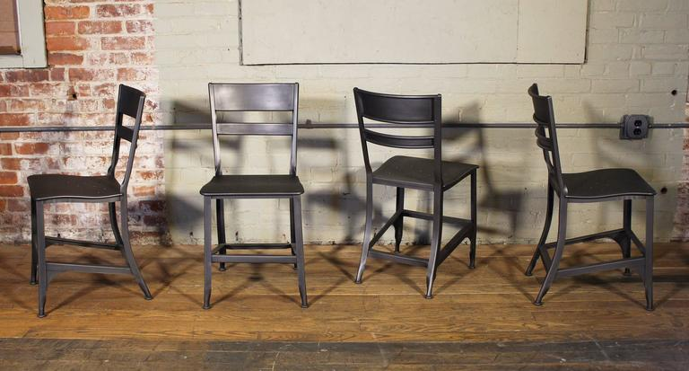 Set of four vintage Toledo dining, side chairs. Refinished in gunmetal color. This listing is for a set of four, we have other quantities available.