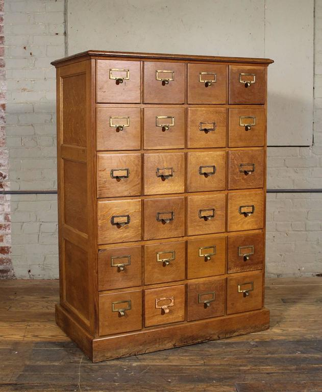"Vintage Industrial multi-drawer oakwood storage cabinet. Overall dimensions are 36 1/4"" in width, 21 5/8"" in depth and 51 3/4"" in height. Inside drawer dimensions are 6 7/8"" in width, 6 1/2"" in height and 18"" in depth."