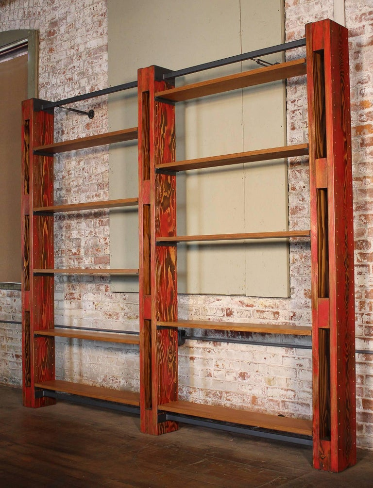 Custom modular shelving storage bookcase system by Get Back Inc. In the vintage Industrial style. System as shown includes ten 8″ shelves, three beams, two top mounting bars, two bottom mounting bars, six adjustable wall mounting brackets, and ten