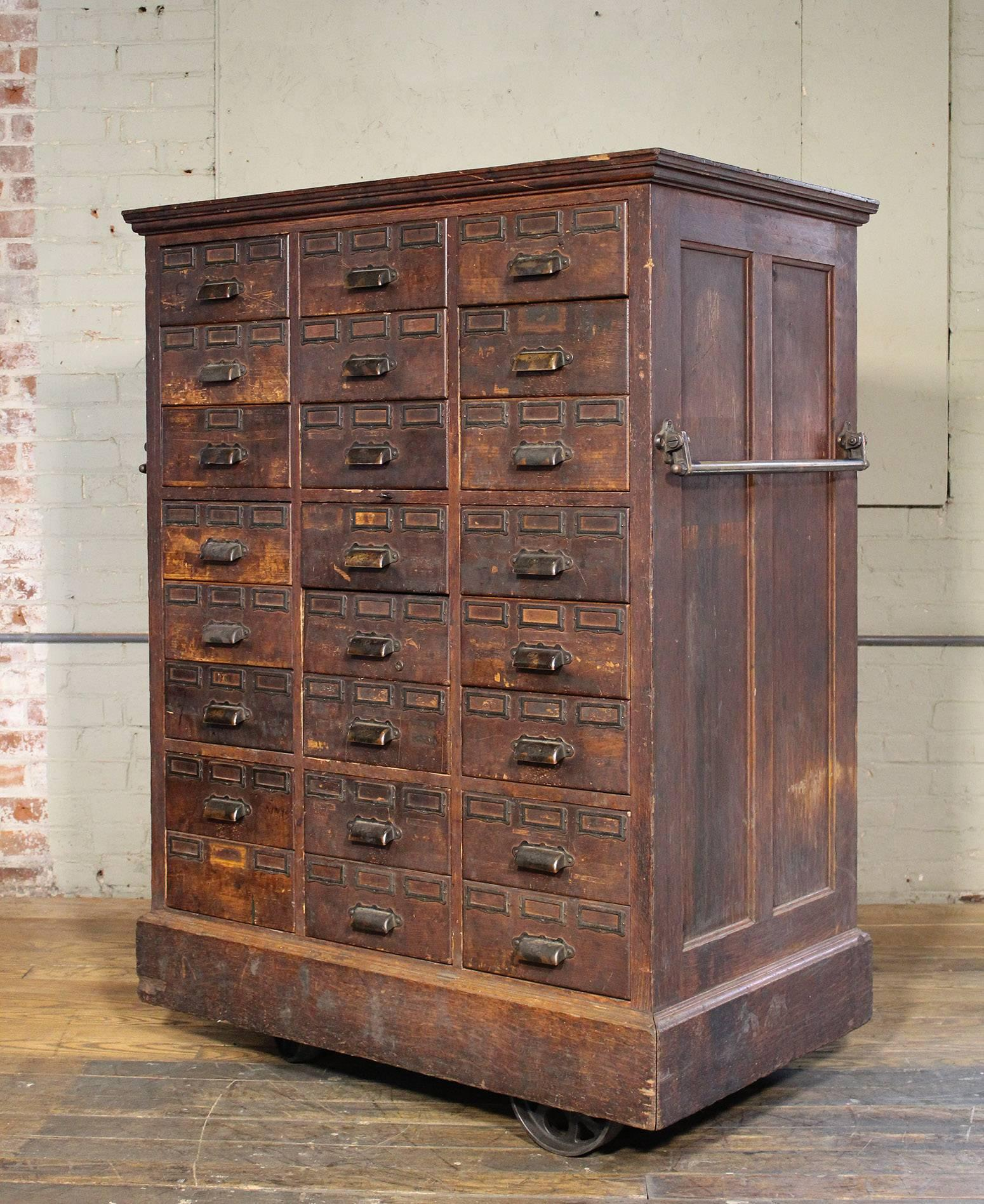 Charmant Rolling Distressed Apothecary Wood Storage Cabinet, Vintage Industrial With  Brass Hardware. Lower Six Drawers