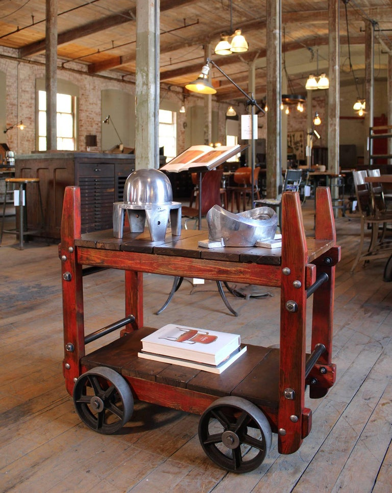 Industrial rolling two-tier bar cart side, end table on castors wheels. Made of wood, steel, cast iron. Shelf heights are 8 1/4