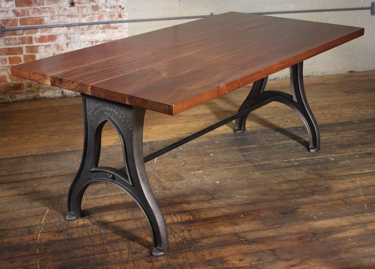 "Bespoke Industrial modern work / office bespoke desk / table with 1 3/4"" wooden walnut top, ""Brown & Sharpe"" Cast iron legs and steel stretcher. Overall dimensions measure 72"" x 36"" x 29 3/4"", space between legs"