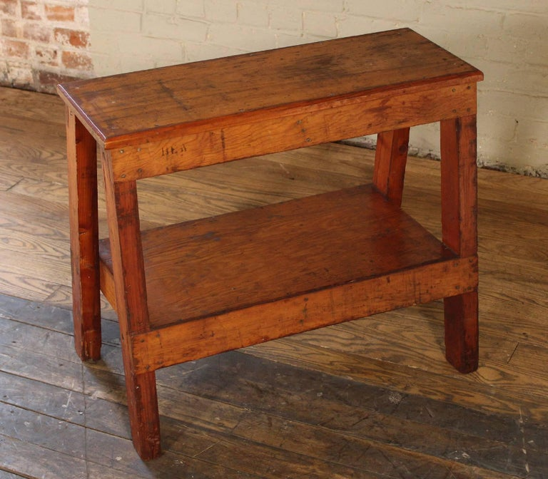 "Vintage factory wooden bench, side/end table. Top measures 29"" x 11 1/4"", overall dimensions are 28"" x 16 3/4"" x 24 3/8"", shelf measures 14 1/4"" x 24 7/8"" x 10 1/2"" in height."
