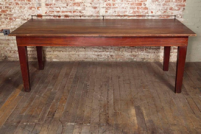 Industrial Vintage Wooden Store Display Table with Brass Rail For Sale