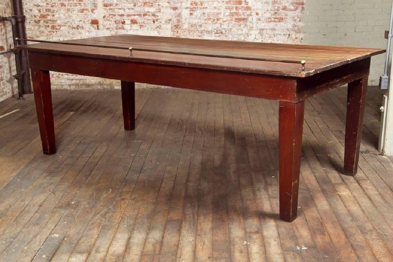 Vintage Wooden Store Display Table with Brass Rail In Distressed Condition For Sale In Oakville, CT