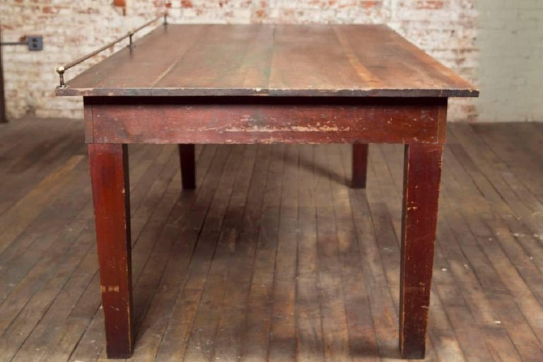Vintage Wooden Store Display Table with Brass Rail For Sale 1