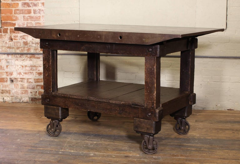 Industrial Rolling Table Kitchen Island, Wood and Cast Iron For Sale