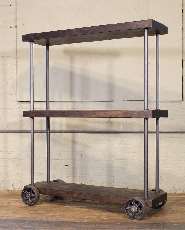 Rough sawn pine and cast iron industrial rolling shelving storage rack unit. Overall height of 53