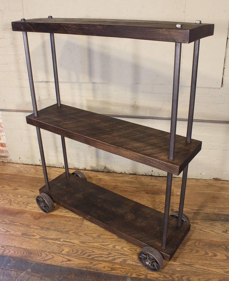 Industrial Rolling Shelving Storage Rack Bookcase, Rough Sawn Pine and Cast Iron In Excellent Condition For Sale In Oakville, CT