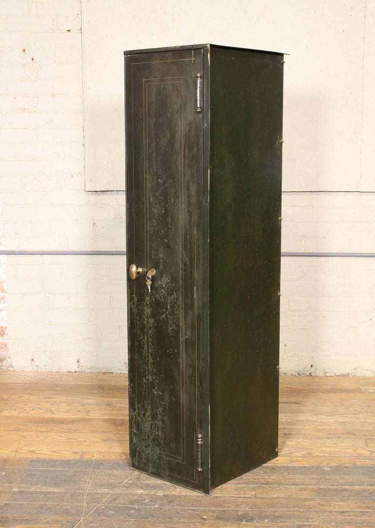 Vintage metal, steel distressed storage locker with lock and key and brass handle. Depth measures 16 1/8