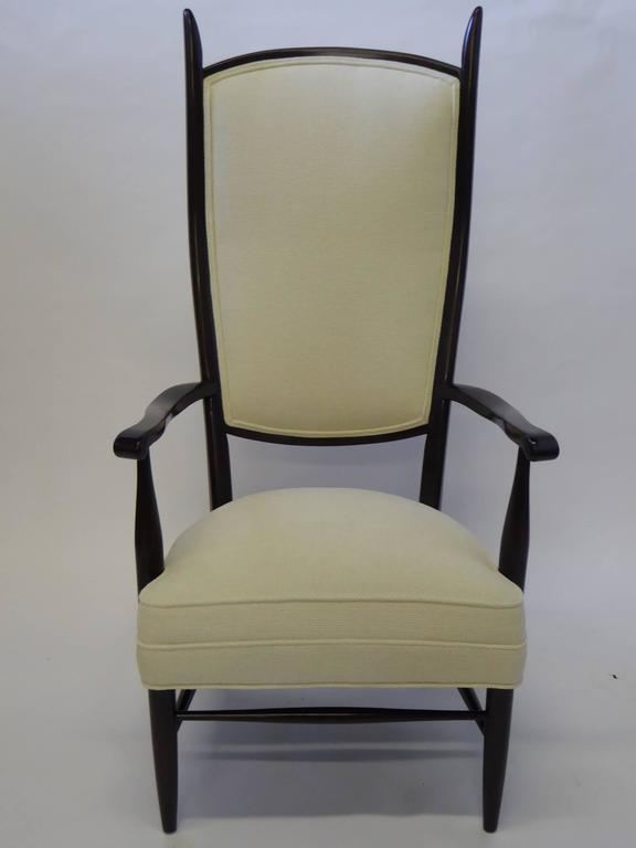 Definitely favoring modern Italian design of the same period, this very highback armchair has a Danish hint of Papa or Chieftain chair appeal, with its points and curves. Fun, sinewy yet strong. The fat seat design is great. Spring upholstered, new