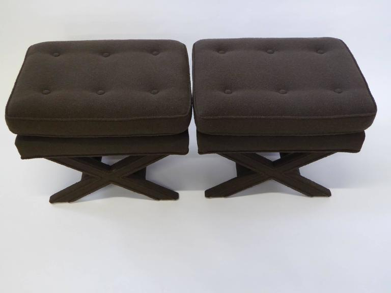 Button tufted and in a warm dark cocoa bouclé fabric, this pair of Billy Baldwin style X-benches are quite urbane and sophisticated. Great welting detail in legs and all around. At the end of the bed, side by side at the cocktail table. Price is for