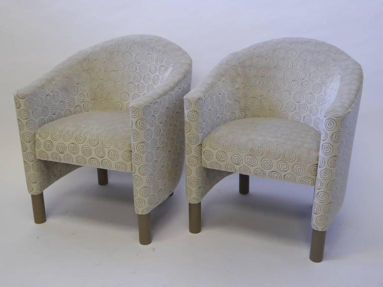 Great scale and style in this pair of club chairs by Brayton International Collection. Newly reupholstered in a luxe neutral swirl design velvet. Armed lounge chairs. Wonderful fat pencil legs. Price is for the pair.  Measurements: 25 1/2