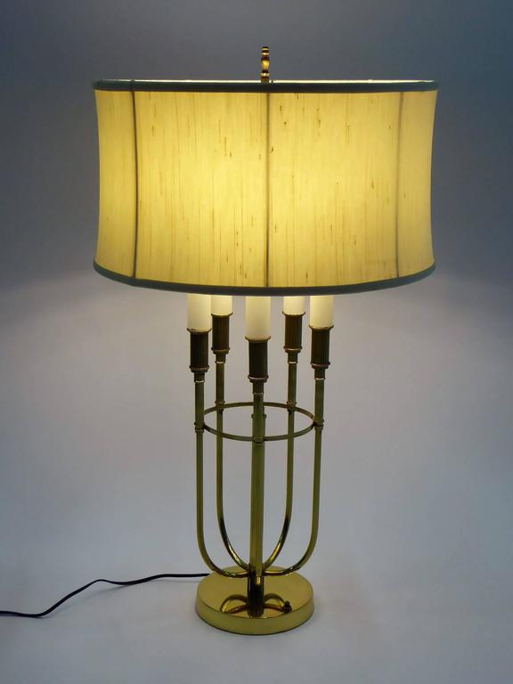 Stellar quality and beautiful craftsmanship with this Mid-Century Modern solid Brass Tommi Parzinger style five candle Bouillotte table lamp. Select two on, three on or five lights on with a turn of the switch. New UL sockets and wiring. Takes five