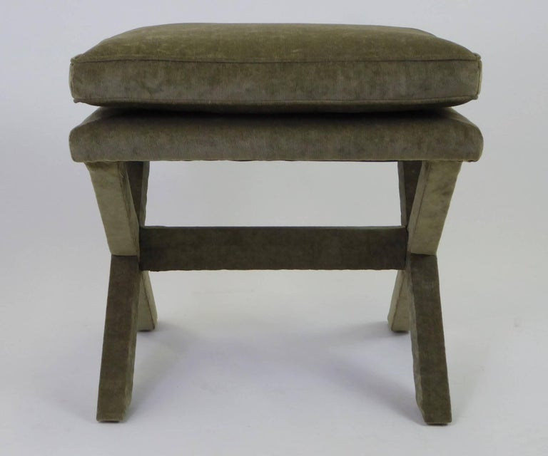 Elegant and iconic form associated with and designed by Billy Baldwin, this 1960s X-bench or stool has been reupholstered in an olive green velvet. Measures: 21 inches x 18 1/2 inches x 21 inches high.