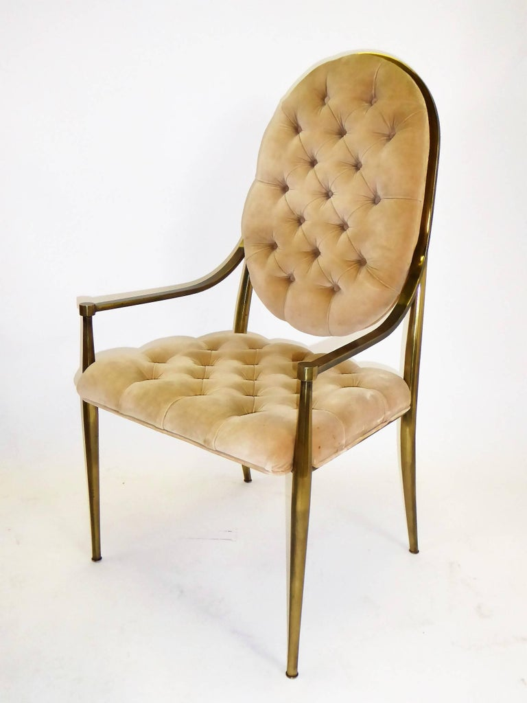 Six Mastercraft dining chairs with antiqued brass frames and tufted velvet upholstery. Firmly Mid-Century Modern, they are best described as Hollywood Regency with their glamour and nod to the traditional and classical. In their original velvet with