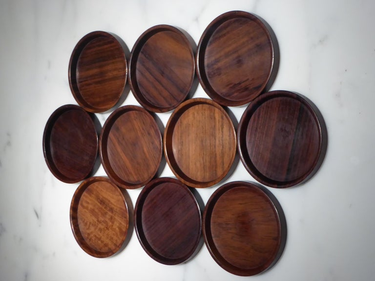 Mid-Century Modern Danish set of 10 carved rosewood coasters from Denmark, 1960s. All in used excellent condition. Each a beautiful creation carved out of solid piece of wood showing off the grain of the rosewood. Saap of Denmark,