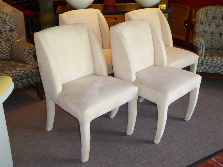 Set of four 1980s sculptural dining chairs by Directional with original bone ultra suede upholstery. Elegant and plush. Tagged directional custom collection and with directional order tag. Original ultra suede with light wear, soil marks. Two chairs