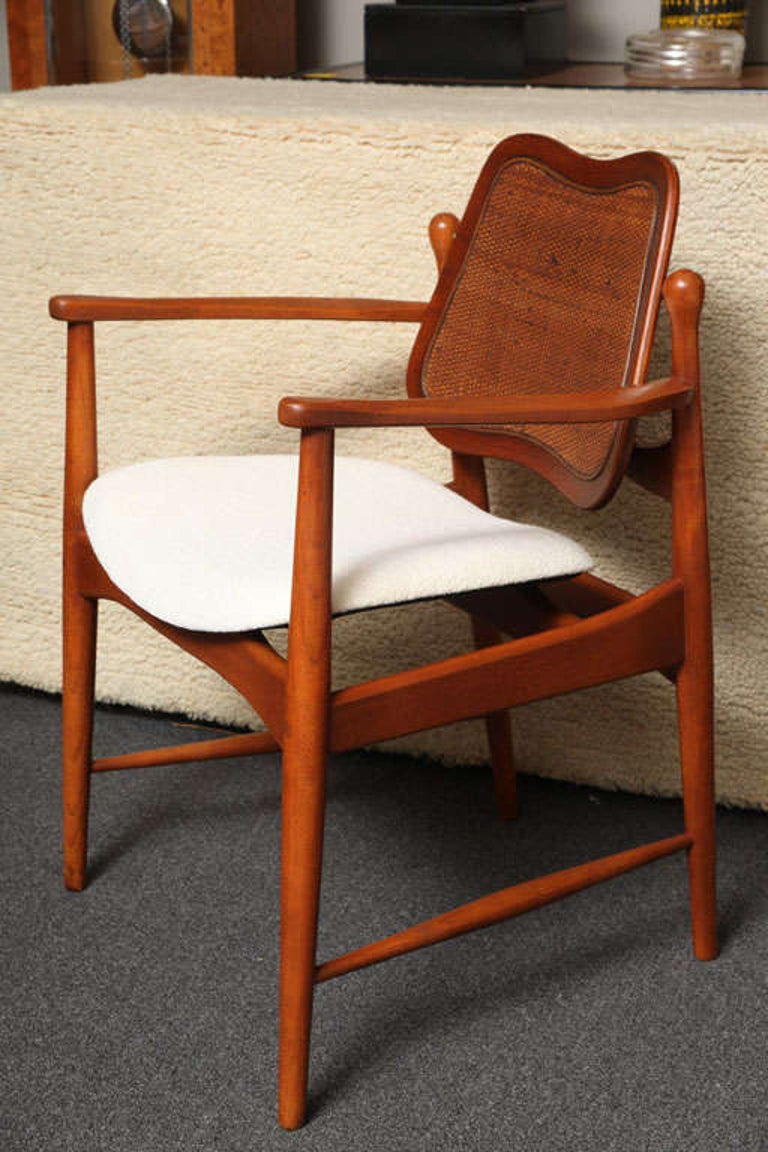 Gorgeous Arne Vodder designed chair in teak with inset caning on the movement adjusting back, floating ergonomic seat newly upholstered in a white chocolate chenille. Classic Danish Modern design, in excellent condition. Measurements: 23 inches