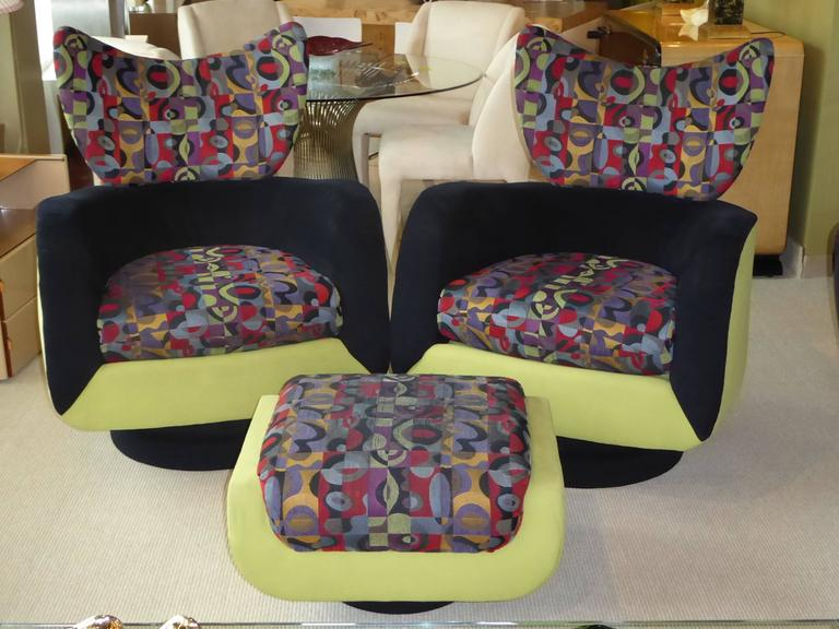 Exceptional Kagan design for Directional, this pair of stylized wingback lounge chairs with an ottoman both swivel and rock. Sumptuously styled with enveloping curves and a large horned neck. In original fabrics, ready for updating. Slight age wear