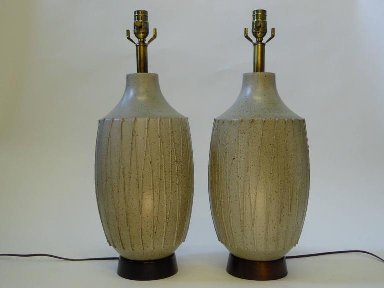 Great David Cressey (1916-2013) 1960s pottery table lamps with applied stringing design with speckled brown glaze over pale green grey ground glaze. Large silk with cord shades included if desired. Rewired and with new UL antiqued brass three level