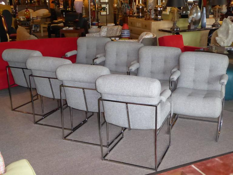 REDUCED FROM $11,000.....In their original grey tweed fabric, blind tufted and plush rolled edge upholstered seats, these eight Milo Baughman armed dining chairs are a classic delight. Excellent chrome finish tubular frames and the fabric are in
