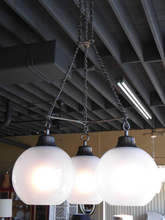 Rare, sought after and designed by Luigi Caccia Dominioni in 1965 and produced by Azucena, the firm he formed In 1947 together with fellow architect Ignazio Gardella and friend Corrado Corradi dell'Acqua. . The Grappolo is a suspension light with