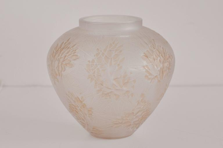 "R. Lalique ""Esterel"" vase, bulbous shape in frosted glass with a stylized floral and leaf pattern."
