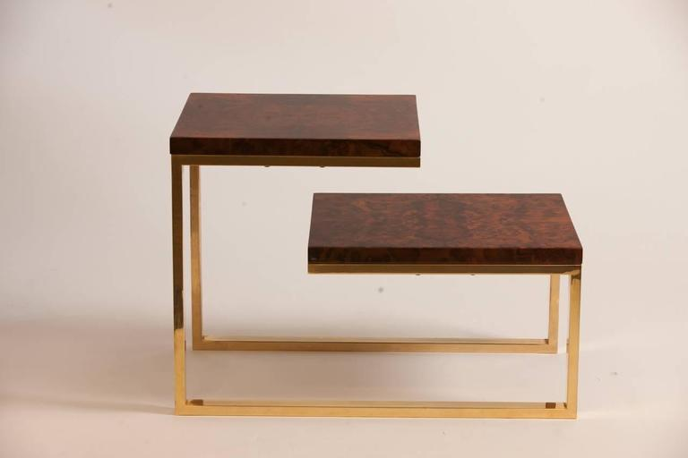 Pair of 1970s French bronzed and lacquered burled wood side tables. Each of the two-tiers feature a lacquered burled wood tableau supported by angular bronze supports.