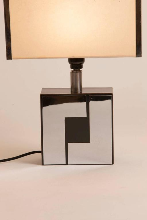 Philippe Jean style chrome and black lacquer table lamp with original shade featuring chrome detail.